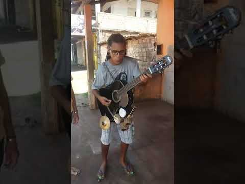 Street artist playing Bob Marley in Brazil with a cool instrument