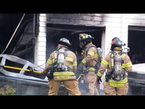 Fire in Snohomish 8-18-14 Firefighters cut  & rip garage door off !
