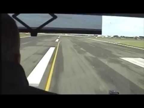 Fire engine racing down runway 27 Jersey Airport
