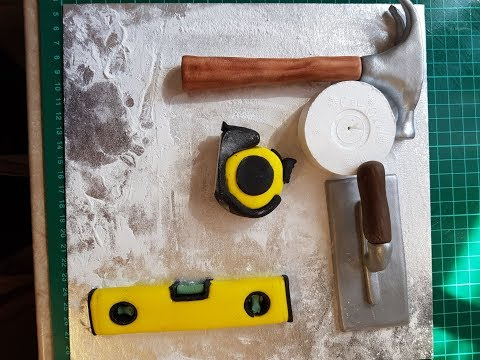 spirit level, hammer, tape measure, and smoother gumpaste tutorial