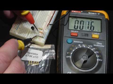 Multimeter measurements current through 2N2222 transistor no load and 470000 ohm base resistor