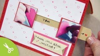 """DESCARGABLES AQUÍ • http://bit.ly/1BKLrSB Mira como hacer un separador navideño •  http://bit.ly/1wJV45o Lo que más me gusta de esta tarjeta es que al jalar las pestañas las 2 fotografías se juntan para hacer 1 sola. Yo usé un corazón pero tu puedes poner una foto de tí y tu pareja dandose un besito (taaan lindo*-*)  Espero que te guste y sobre todo que sorprenda a tu otra mitad cuando se la des ;)  // [English: Learn how to do this card. I dont even know how to call it in english, is like a """"my other half"""" card. You pull the tab and will get a joined photo with a lot of message and meaning.  Fin all of the downloadables here: http://bit.ly/1BKLrSB ]  + ideas: www.craftingeek.me  SUSCRIBETE http://bit.ly/PonteCrafty   -------  • FACEBOOK: http://www.facebook.com/craftingeek • INSTAGRAM: http://instagram.com/craftingeek • TWITTER: http://www.twitter.com/craftingeek • Plus: http://bit.ly/RJCxyG ----  Musica:  Kevin Macleod"""