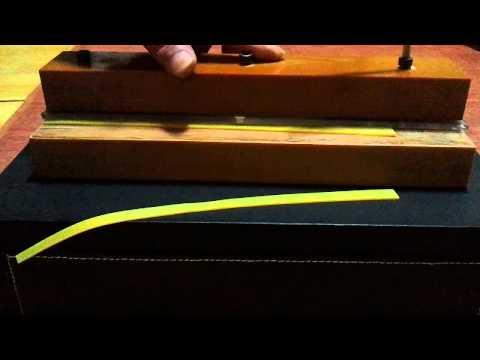 cut a rubber band/slingshot
