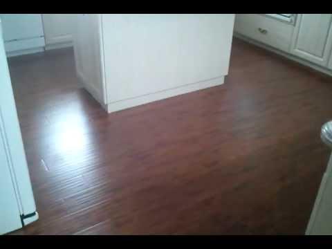 Hand scraped Teak wood Laminate Flooring Floated over existing tile floors.