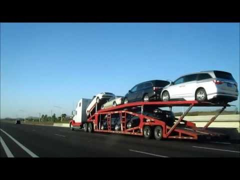 Car Transport Trailer pulled by a Freightliner Truck