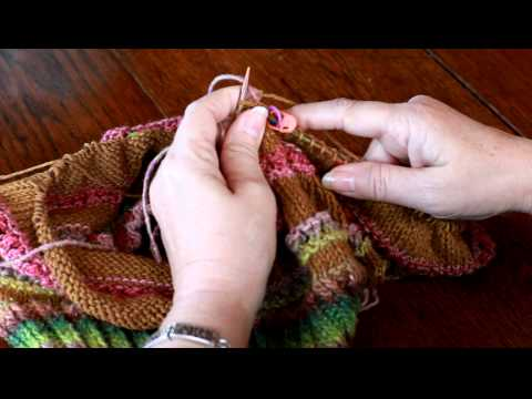 Knitting carrying yarn up.