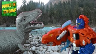 Dinosaur toys battling Rescue Bots Transformers toys
