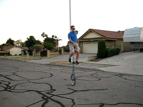 Riding my 6 foot Giraffe Unicycle