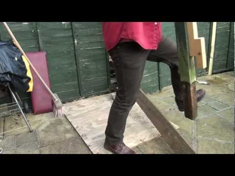 Pulling a wooden fence post using a homemade lever