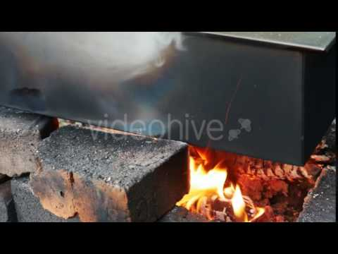 Smokehouse - a Metal Box With the Meat on the Fire