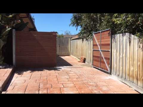 Horizontal merbau double driveway gates. Nailed it Fencing
