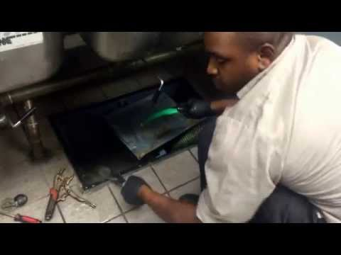 Grease trap cleaning, maintenance, drain cleaning, pipe backup prevention.video1