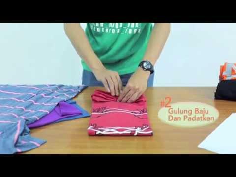 Cara Praktis Menggulung Baju Saat Traveling