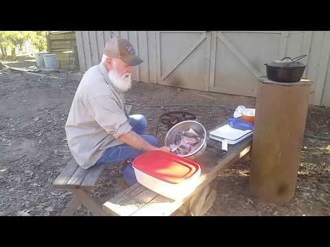 DEEP FRIED CATFISH in CAST IRON on a ROCKET STOVE