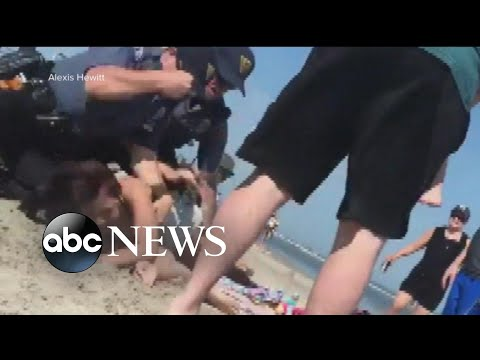 Policeman punches young woman in the head on the Jersey Shore