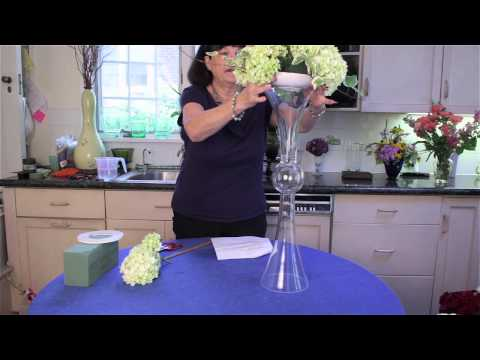 How to Decorate a Tall, Clear Centerpiece Vase : Flower Arrangements