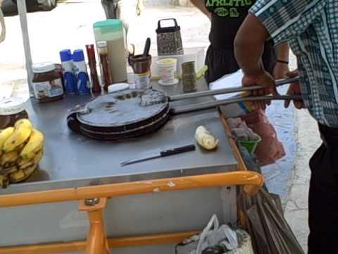 Preparing marquesitas along the beachwalk on Isla Mujeres