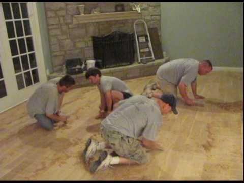 hand distressing hardwood floor.avi