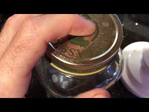 Sealing one piece mason jar in vacuum chamber.