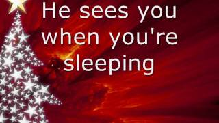 Miley Cyrus - Santa Claus Is Coming To Town w/ Lyrics