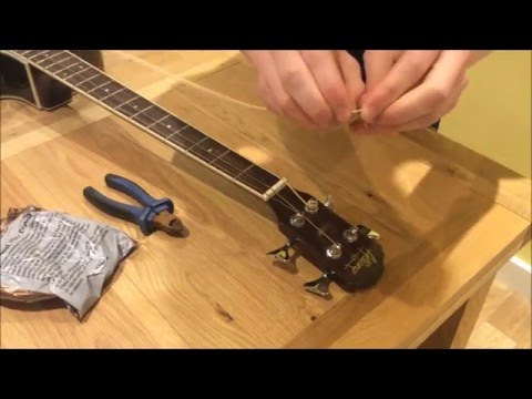 How To Restring (Change Strings On) an Acoustic Bass Guitar