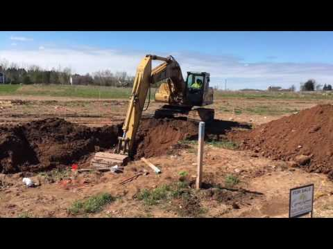 Digging Sewer  & Water in Greenville, WI