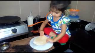 2 years old girl making chapati...