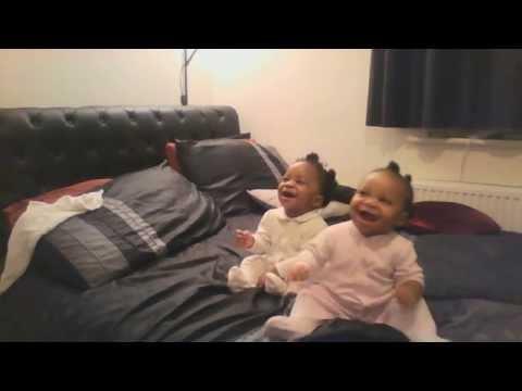 Twin babies dancing