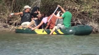 Immigrants crossing the Rio Grande river