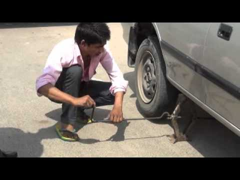 Replacement  of tyre using Car Jack