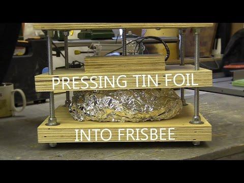 Pressing Tin Foil into Frisbee