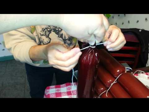 How to stuff a summer sausage and tie it off.