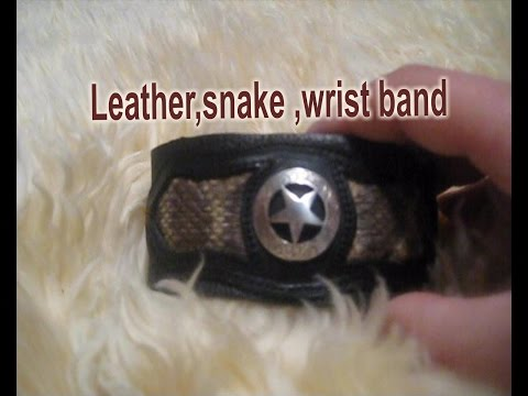 Leather wrist Band with Texas star Concho with snake skin. # 409