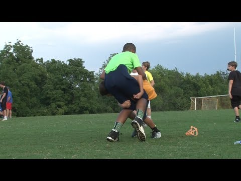 Rugby-style tackling taught at local youth football leagues to reduce risk of concussions