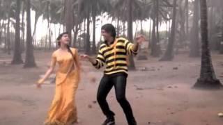 Kimi Katkar in wet yellow saree (rain song)