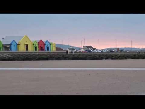 Rhyl, Snowdonia and Llandudno at Sunset from Prestatyn Beach Wales UK