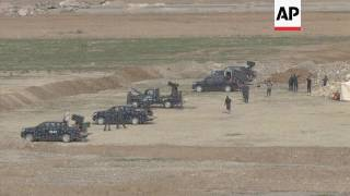 Helicopter fires on targets in battle for Mosul