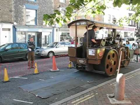 Making a giant linocut print with a steam roller