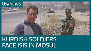 Kurdish soldiers face ISIS militants across