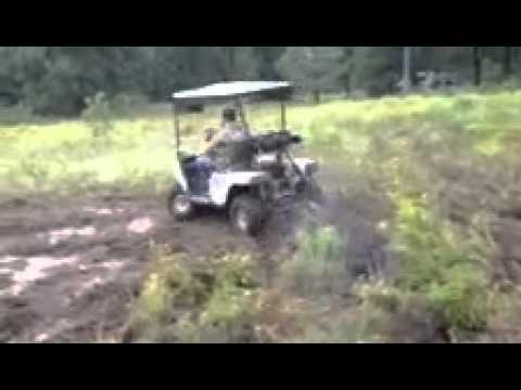 Ezgo golf cart with a ttr125 dirt bike motor play in mud