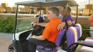 Tim Bourret receives new golf cart from Dabo