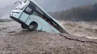 Download Bus swept away by floods in northern India Video