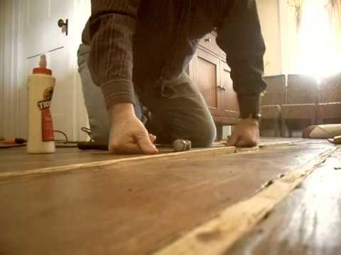 3-Repairing gaps in wood floors.  Step three of four.  Hammer in the splints.