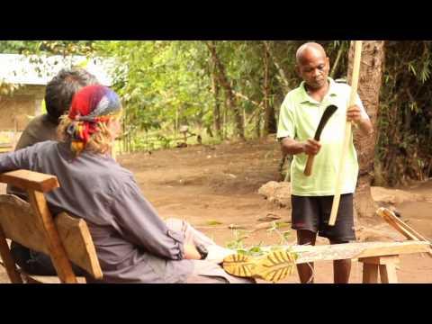 Aeta tribesman making bamboo bow, Zambales, Philippines