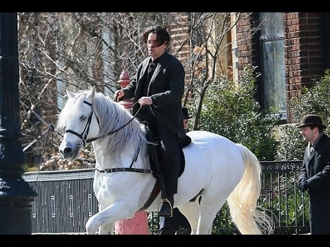 Not just horsing around! Colin Farrell tears up the streets of New York galloping on his white steed