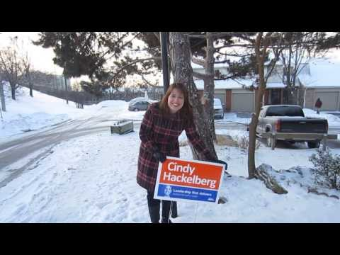 Cindy Hackelberg putting up campaign sign in the Cold