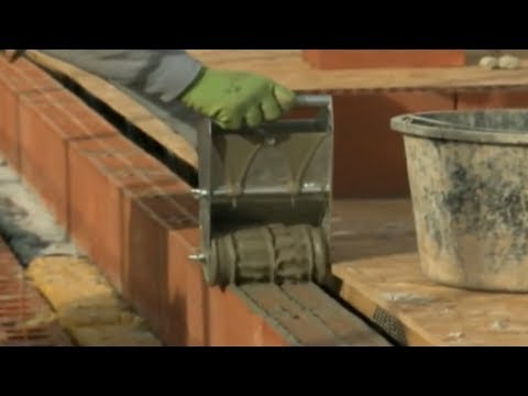 Brick masonry how to smear a thin layer of mortar on a wall of ceramic block wall warming with their