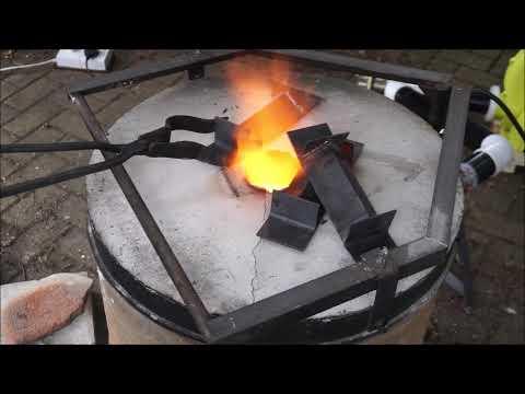 Homemade oil fired furnace. Melting brass.