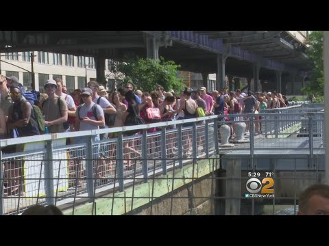 Crowds Wait Hours To Take City Ferry To Rockaway Beach
