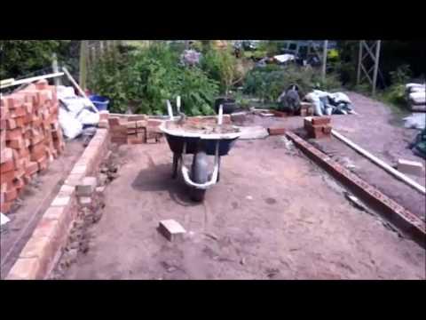 Joan's greenhouse base with herringbone path